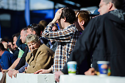 A Bristol Rovers fan looks on with her side losing 3-2 - Photo mandatory by-line: Rogan Thomson/JMP - 07966 386802 - 19/04/2014 - SPORT - FOOTBALL - Fratton Park, Portsmouth - Portsmouth FC v Bristol Rovers - Sky Bet Football League 2.