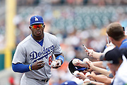 DETROIT, MI - JULY 9: Yasiel Puig #66 of the Los Angeles Dodgers signing autographs for fans before the interleague game against the Detroit Tigers at Comerica Park on July 9, 2014 in Detroit, Michigan. (Photo by Joe Robbins)