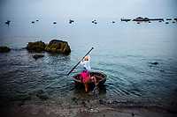 Fishermen go out in the early morning in a traditional bowl-shaped boat for their daily catch on Cham Island, in central Vietnam. The Cham Islands in Vietnam are a UNESCO-recognized biosphere reserve.