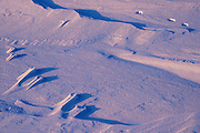 Abstract pattern of wind blown snow with snowshoe hare tracks<br /> Grande Pointe<br /> Manitoba<br /> Canada