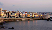 General view of Lungomare di Levante Elio Vittorini waterfront, Ortigia, Syracuse, Sicily, pictured on September 14, 2009, at dawn. The island Ortigia is the historic centre of Syracuse. Today the city is a UNESCO World Heritage Site. Picture by Manuel Cohen.