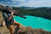 Film maker Joe Yaggi surveys Kelimutu Lakes, Flores