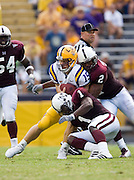 Baton Rouge, LA - SEPTEMBER 30:  Matt Flynn #15 of the LSU Tigers gets tackled against the Mississippi State Bulldogs at Tiger Stadium on September 30, 2006 in Baton Rouge, Louisiana.  The Tigers defeated the Bulldogs 48 - 17.  (Photo by Wesley Hitt/Getty Images) *** Local Caption *** Matt Flynn
