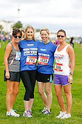 06/08/2012 No fee for Repro: Orla and Niamh Sheehan, Deirdre McLoughlin and Dee McGee all from Portmarnock are pictured warming up for the DLR Bay 10K road race. Pic Jason Clarke Photography