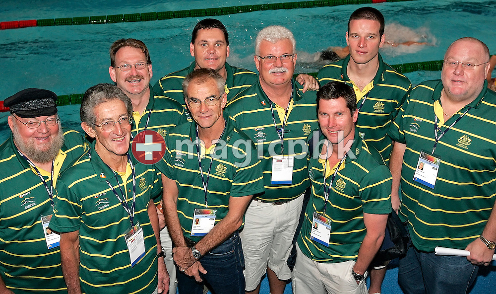 (L-R) Australian coaches Roger Bruce, John Rodgers, Wayne Lawes, Peter Gartrell, Rohan Taylor, Tony Shaw, Shannon Rollason, John Fowlie and Alan Thompson pose for a photo in the Duncan Goodhew pool at the FINA Swimming World Championships (25m) in Manchester, Great Britain, Thursday, April 10, 2008. (Photo by Patrick B. Kraemer / MAGICPBK)