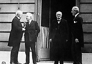 Paris Peace Conference which led to Treaty of Versailles (1919) after the end of World War l.  Meeting between Prime Ministers, left to right, Lloyd George (GB),  Orlando (Italy), Clemenceau (France) and President Woodrow Wilson (USA).
