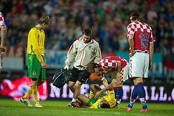 OSIJEK, CROATIA - Sunday, May 23, 2010: Wales' Neil Taylor receives treatment for a foot injury from physiotherapist Dyfri Owen during the International Friendly match against Croatia at the Stadion Gradski Vrt. (Pic by David Rawcliffe/Propaganda)