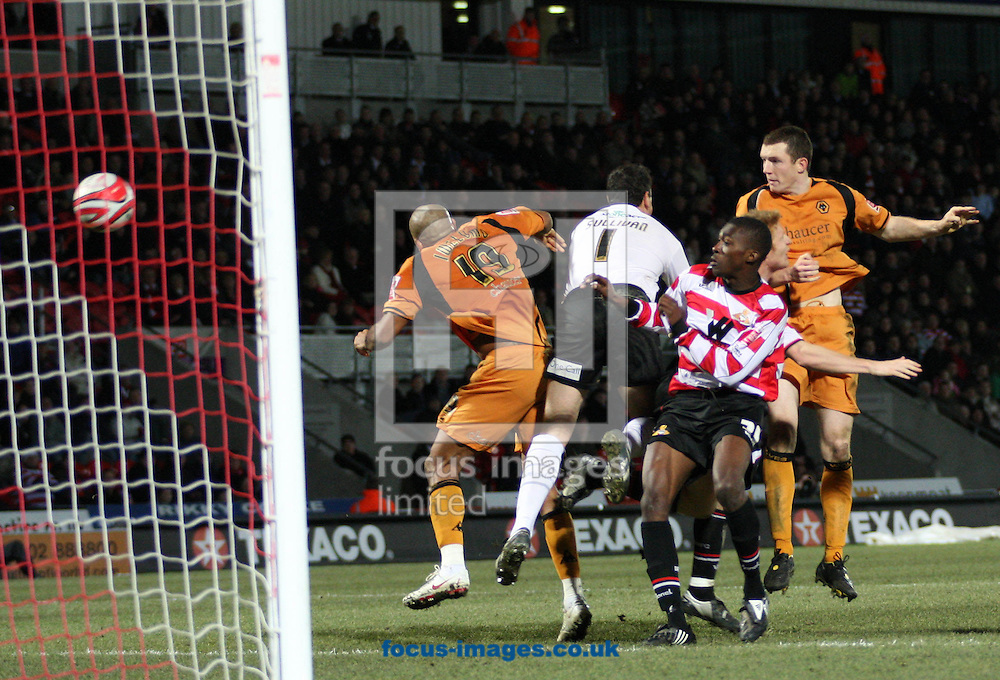Doncaster - Saturday December 20th 2008: Neill Collins of Wolverhampton Wanderer's scores the winning goal during the Coca Cola Championship match at The Keepmoat Stadium Doncaster. (Pic by Steven Price/Focus Images)