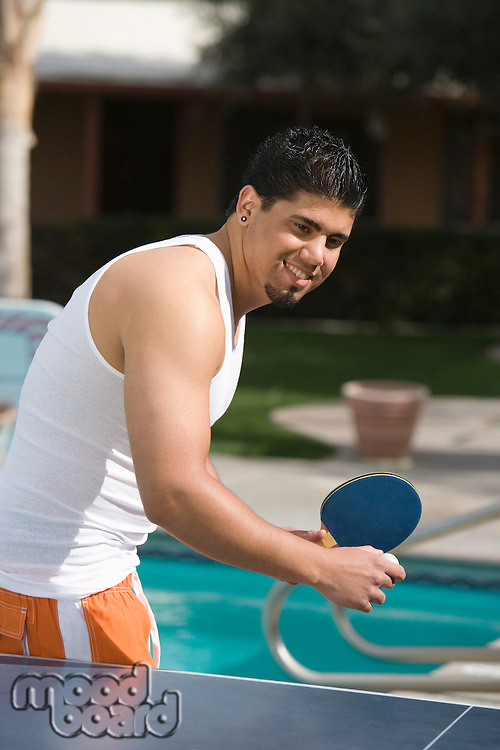 Young Man Playing Table Tennis Outdoors