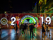"23 NOVEMBER 2018 - BANGKOK, THAILAND:  People in front of the ""World of Happiness,"" the Christmas display at Central World, a large mall in Bangkok. Although Thailand is an overwhelmingly Buddhist country, the commercial aspects of Christmas are widely observed, especially in Thailand's urban areas, which have large concentrations of Europeans and Americans.     PHOTO BY JACK KURTZ"