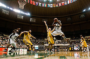 Ohio's Bert Whittington IV pulls up for a jump shot against Central Michigan at th Convo. photo by Kevin Riddell