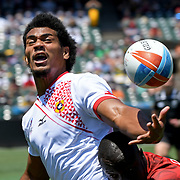 A Tongan player makes a superb effort to retain a pass at the World Cup 7's USA, AT&T Park, San Francisco, California, USA.  Kenya stayed consistent, beating the Kingdom 19-7.  Photo by Barry Markowitz, 7/20/18, 12pm