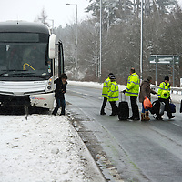 Heavy Snow in Perthshire...22.01.13<br /> As the snow continues to fall this National Express coach to Inverness came to an abrupt stop near Gleneagles after slipping into the central reservation barrier on the A9. Pictured police bring traffic on the A9 to a halt as they offload the passengers to another coach.<br /> Picture by Graeme Hart.<br /> Copyright Perthshire Picture Agency<br /> Tel: 01738 623350  Mobile: 07990 594431