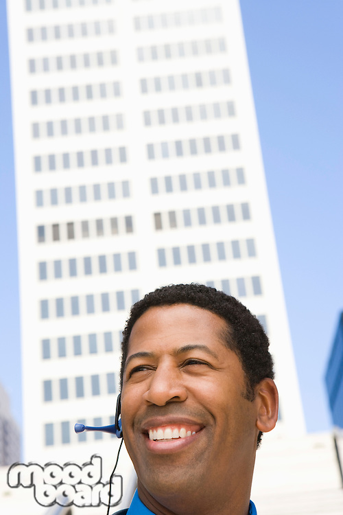 Portrait of businessman with headset, outdoors