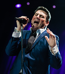 © Licensed to London News Pictures. 17/03/2015. London, UK.   Spandau Ballet performing live at The O2 Arena.   In this picture - Tony Hadley. Spandau Ballet are a British new wave band formed in London in the late 1970s, composed of members Tony Hadley (lead vocals, synthesisers), Gary Kemp ( guitar, keyboards, backing vocals), Steve Norman (saxophone, guitar, percussion), John Keeble –(drums, backing vocals), <br /> Martin Kemp (bass).  Photo credit : Richard Isaac/LNP