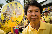 05 DECEMBER 2012 - BANGKOK, THAILAND:  A woman on the Royal Plaza Wednesday holds up a picture of the King and Queen while she waits to see Bhumibol Adulyadej, the King of Thailand, before his public audience at the Mukkhadej balcony of the Ananta Samakhom Throne Hall. December 5 is a national holiday. It's also celebrated as Father's Day. Celebrations are being held across the country to mark the birthday of Bhumibol Adulyadej, the King of Thailand.   PHOTO BY JACK KURTZ