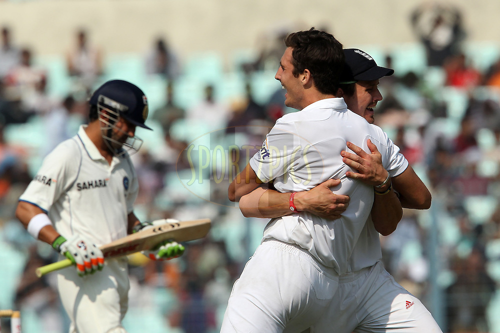 Steven Finn of England celebrates the wicket of Gautam Gambhir of India with Nick Compton of England during day four of the 3rd Airtel Test Match between India and England held at Eden Gardens in Kolkata on the 8th December 2012..Photo by Ron Gaunt/BCCI/SPORTZPICS ..Use of this image is subject to the terms and conditions as outlined by the BCCI. These terms can be found by following this link:..http://www.sportzpics.co.za/image/I0000SoRagM2cIEc