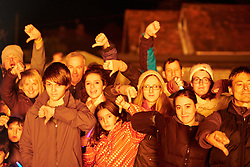 © Licensed to London News Pictures.  02/11/2013. BUCKINGHAMSHIRE, UK. Local residents give a thumbs down sign while watching a 60 foot scale model of a HS2 train crossing a bridge burns as part of the Speen Village annual bonfire and firework display. <br /> <br /> Despite the village not being on the proposed route local residents are strongly opposed to the project as a waste of money. The model was created using recycled materials and was free to make. <br /> <br /> Photo credit: Cliff Hide/LNP