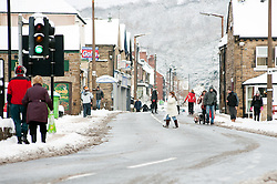 The A6135 Station Rd Chapeltown Sheffield, people choose to walk rather than take their cars in the most widespread Snows to hit Britain for 20 years.1st December 2010.Images © Paul David Drabble