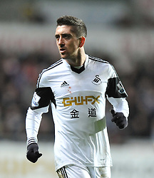 Swansea City's Pablo Hernandez with blood on his shirt after a clash. - Photo mandatory by-line: Alex James/JMP - Tel: Mobile: 07966 386802 28/01/2014 - SPORT - FOOTBALL - Liberty Stadium - Swansea - Swansea City v Fulham - Barclays Premier League