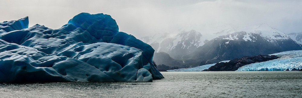 A huge Ice Berg floats slowley away from Glacier Grey in Torres del Paine National Park, Chile.