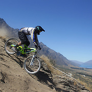 Reece Potter from Nelson in action during the New Zealand South Island Downhill Cup Mountain Bike series held on The Remarkables face with a stunning backdrop of the Wakatipu Basin. 150 riders took part in the two day event. Queenstown, Otago, New Zealand. 9th January 2012. Photo Tim Clayton