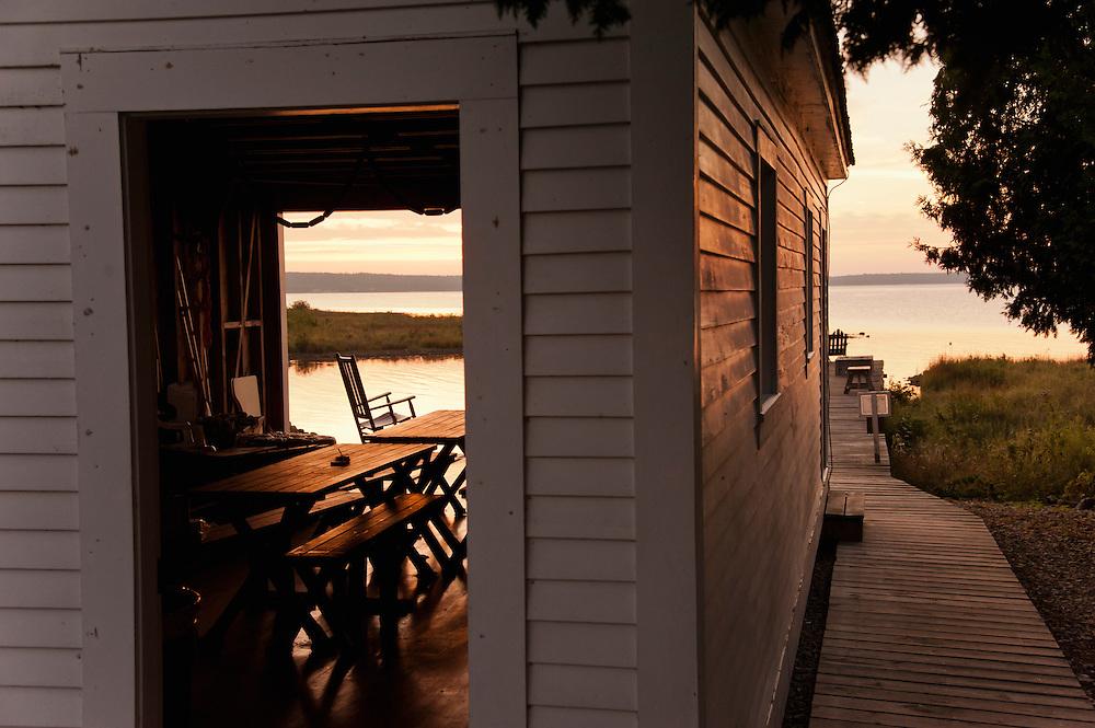 Early morning at the boathouse of the St. Helena Island Lighthouse on Lake Michigan near Mackinaw City, Michigan.