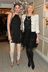 Left to right, SASHA VOLKOVA and MEREDITH OSTROM at the launch of Mrs Alice in Her Palace - a fashion retail website, held at Fortnum & Mason, Piccadilly, London on 27th March 2014.