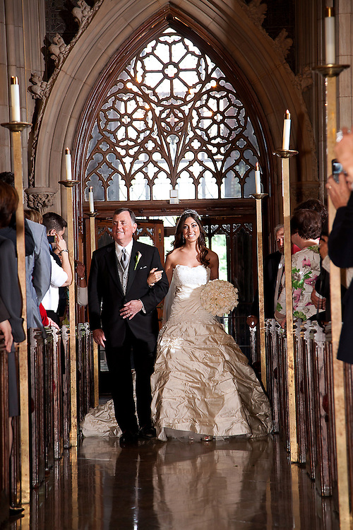 Proud father walks his daughter down the aisle of her beautiful church wedding