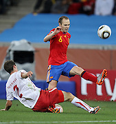 Stephan LICHTSTEINER (L) challenegs Andres INIESTA during the 2010 FIFA World Cup South Africa Group H match between Spain and Switzerland at Durban Stadium on June 16, 2010 in Durban, South Africa.