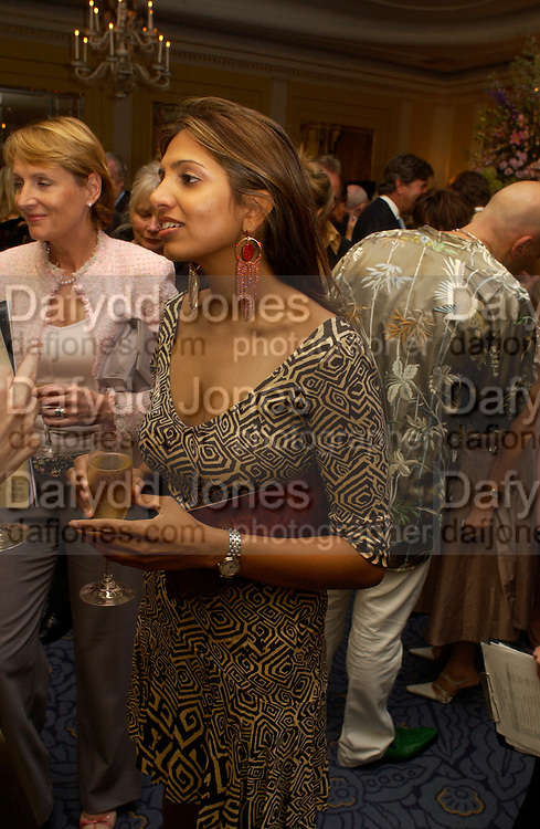 Divia Lalvani, Bruce Oldfield celebrates the publication of 'Rootless' party in aid of Crimestoppers. Claridges. 22 September 2004. SUPPLIED FOR ONE-TIME USE ONLY-DO NOT ARCHIVE. © Copyright Photograph by Dafydd Jones 66 Stockwell Park Rd. London SW9 0DA Tel 020 7733 0108 www.dafjones.com