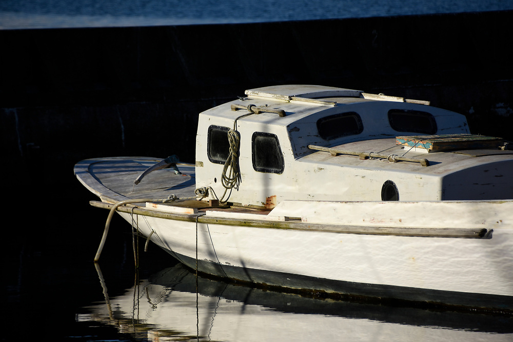Negelected boat, sailing craft in a marina