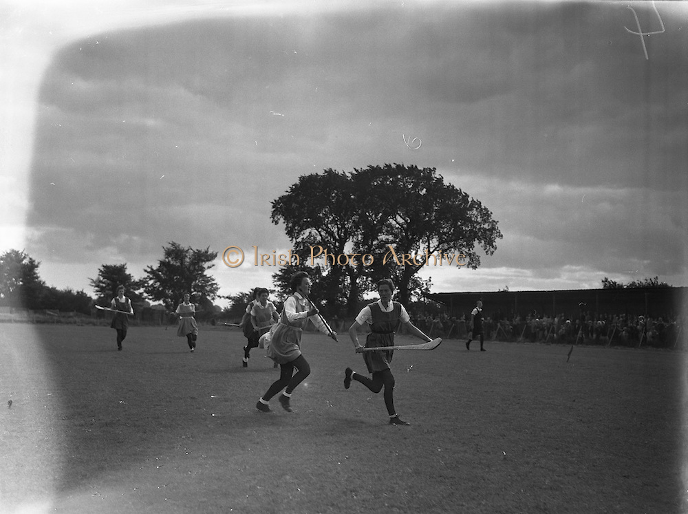 08/09/1957<br /> 09/08/1957<br /> 08 September 1957<br /> <br /> Camogie semi-final, Cork vs Dublin.