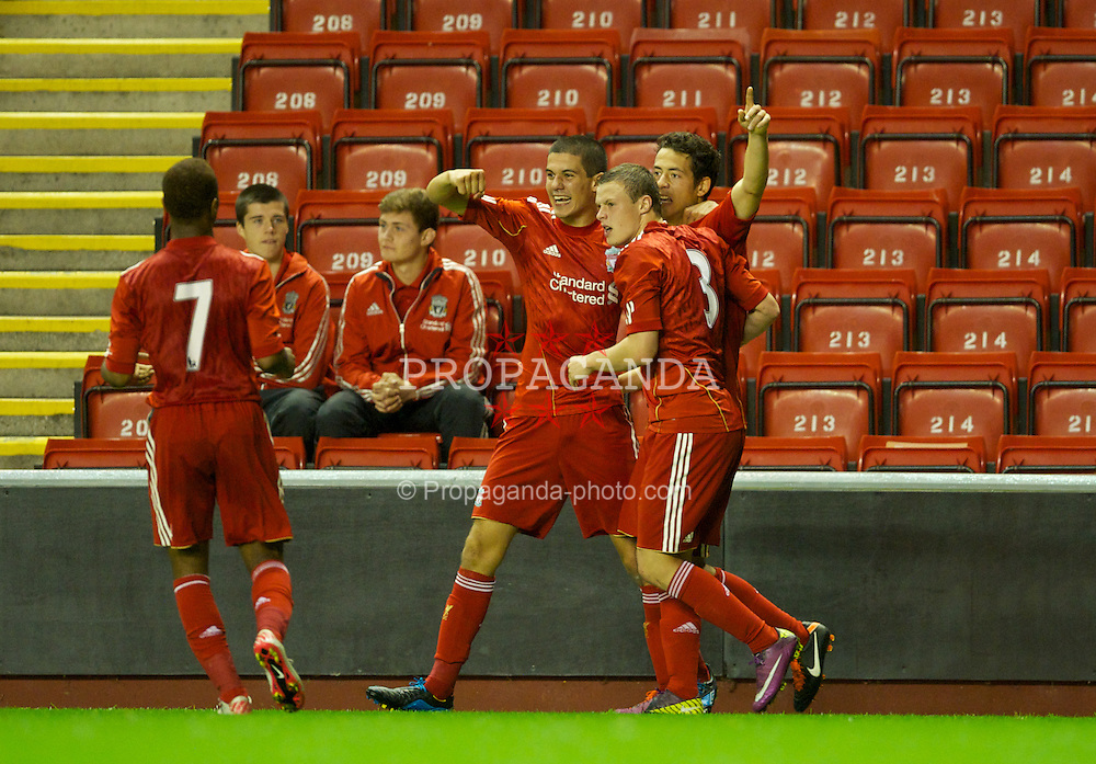 LIVERPOOL, ENGLAND - Wednesday, September 14, 2011: Liverpool's Krisztian Adorjan celebrates after crossing to create the equalising goal as a VfL Wolfsburg player scores an own-goal during the NextGen Series Group 2 match at Anfield. (Pic by David Rawcliffe/Propaganda)