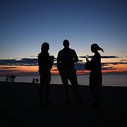 A view of the sunset from Galley Beach beachside restaurant, Nantucket, as patrons relax before a meal. Nantucket Island, Massachusetts, USA. Photo Tim Clayton