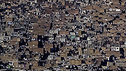A hillside filled with houses in Teheran. The world population passed 7 billion in 2012. By 2050 we could be as many as 10.9 billion, according to the United Nations.