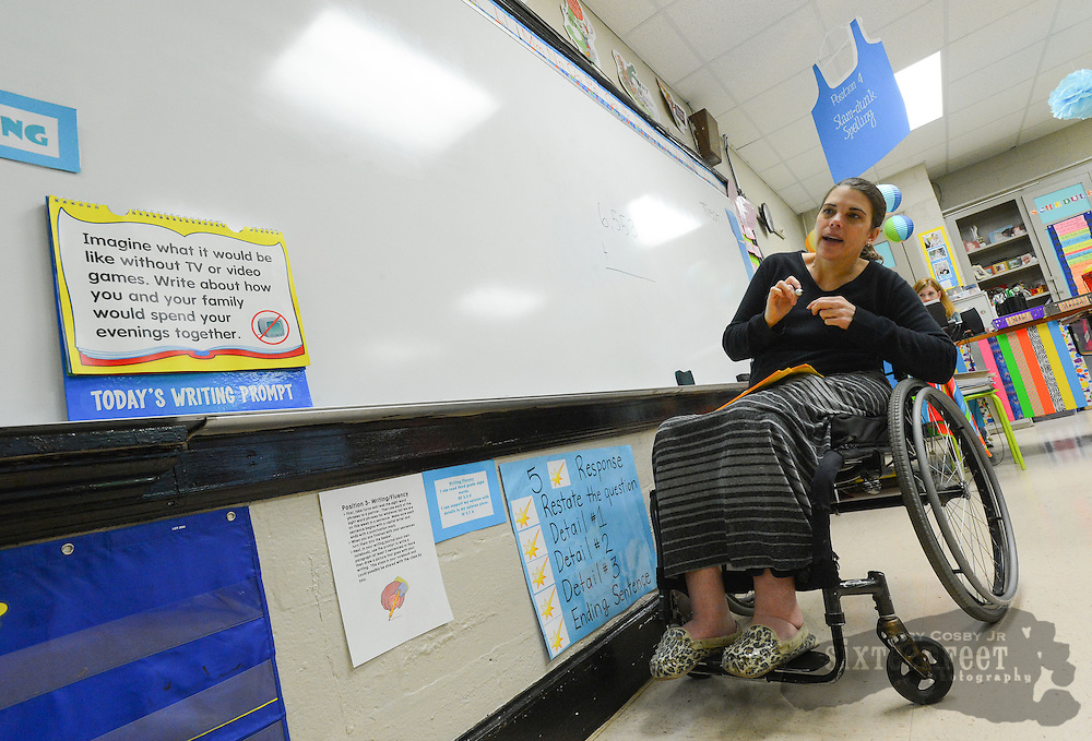 Gary Cosby Jr./Decatur Daily    Courtney Carpenter Boyll was a rising star athlete in 1994 when a car wreck left her paralyzed.   Twenty years later she is a wife, mother of three and third grade teacher and does it all as a paraplegic.  Courtney works with her Moulton Elementary third graders on their Number of the Day exercise.
