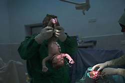A doctor at the Juba Teaching Hospital in South Sudan holds a newborn baby.