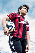 portrait young woman with soccer ball by Andrea Robles