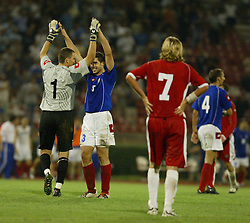 BELGRADE, SERBIA & MONTENEGRO - Wednesday, August 20, 2003: Serbia & Montenegro's goalkeeper Dragoslav Jervic and Ivica Dragutinovic celebrate their 1-0 victory over Wales as Robbie Savage looks during the UEFA European Championship qualifying match at the Red Star Stadium. (Pic by David Rawcliffe/Propaganda)