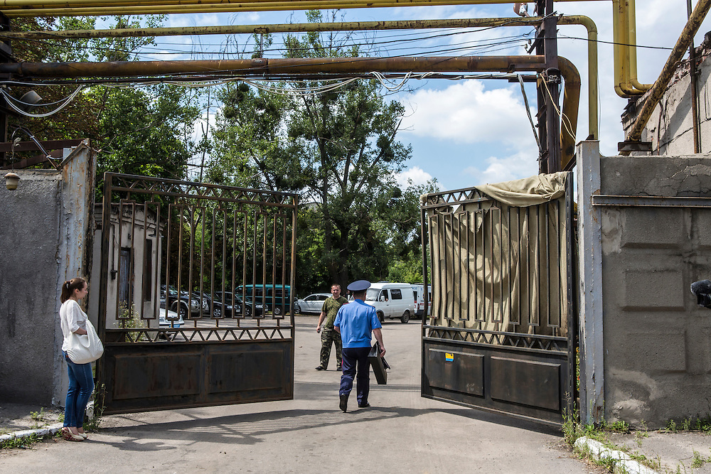 KHARKIV, UKRAINE - JULY 22: The gate of the Malyshev Factory, a state-owned producer of heavy machinery where a train transporting the victims of Malaysia Airlines flight MH17 was taken on July 22, 2014 in Kharkiv, Ukraine. The bodies of the victims are expected to be flown to Amsterdam later today. Malaysia Airlines flight MH17 was travelling from Amsterdam to Kuala Lumpur when it crashed killing all 298 on board including 80 children. The aircraft was allegedly shot down by a missile and investigations continue over the perpetrators of the attack.  (Photo by Brendan Hoffman/Getty Images) *** Local Caption ***
