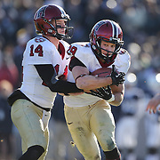 Paul Stanton, Harvard, in action during his four touchdowns performance in the Yale V Harvard, Ivy League Football match at Yale Bowl. Harvard won the game 34-7 giving Harvard a share of the 2013 Ivy League title.  The game was the 130th meeting between Harvard and Yale in the historic rivalry that dates back to 1875. New Haven, Connecticut, USA. 23rd November 2013. Photo Tim Clayton