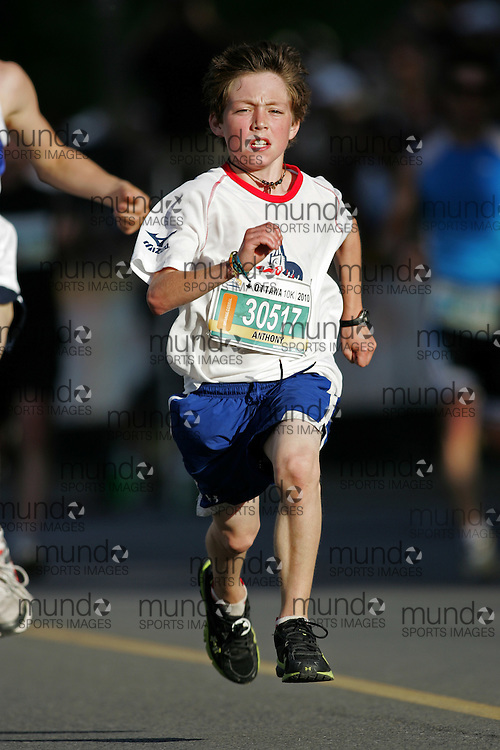 (Ottawa, ON --- May 29, 2010) ANTHONY SCATTOLON running in the 10km race during the Ottawa Race Weekend. Photograph copyright Sean Burges / Mundo Sport Images