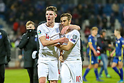 England midfielder Declan Rice and England midfielder Harry Winks celebrate at full time during the UEFA European 2020 Qualifier match between Kosovo and England at the Fadil Vokrri Stadium, Pristina, Kosovo on 17 November 2019.
