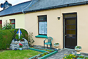 Grotto and statue of the Blessed Virgin Mary in Catholic tradition in front of house in Kilkee, County Clare, West of Ireland