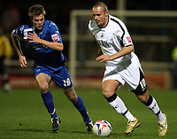 Photo: Rich Eaton.<br /> <br /> Peterborough United v Swansea City. Johnstone's Paint Trophy. 31/10/2006. Lee Trundle right of Swansea tries to get past Shane Huke of Peterborough