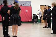 """Shawna Brown watches as her students perform their dance routines they learned in a ballroom dancing class at Colin Powell Elementary in Grand Prairie, Texas on October 7, 2016. """"CREDIT: Cooper Neill for The Wall Street Journal""""<br /> PUBLICS"""