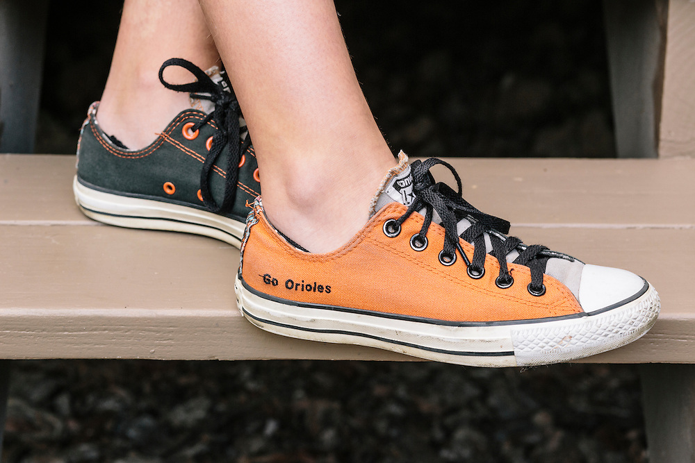 """Meredith Case Ellison, 13, a Washington D.C. resident and lifelong Orioles fan, ordered custom orange and black Converse shoes with the slogan """"Go Orioles"""" stitched into the side."""