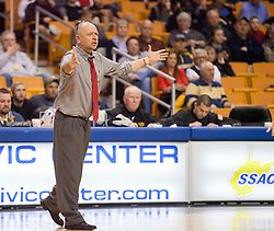 Hurricane Head Coach Lance Sutherland argues a call against Huntington during a semi-final game at the Charleston Civic Center.