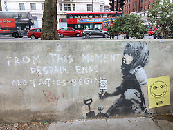 April 29, 2019 - London, United Kingdom - New Banksy 'masterpiece' on a wall in Marble Arch...A new piece of 'Banksy' artwork left after the Extinction Rebellion protesters left Marble Arch last week could be worth £1 million. If genuine - and art experts claim it is definitely him - it could sell for around £1million, but only if it can be removed. Westminster Council have now placed a protective perspex plate over the piece of street art as it had already been the subject of some defacement with red and blue writing and a yellow 'smiley' leaflet stuck to the wall. (Credit Image: © Keith Mayhew/SOPA Images via ZUMA Wire)